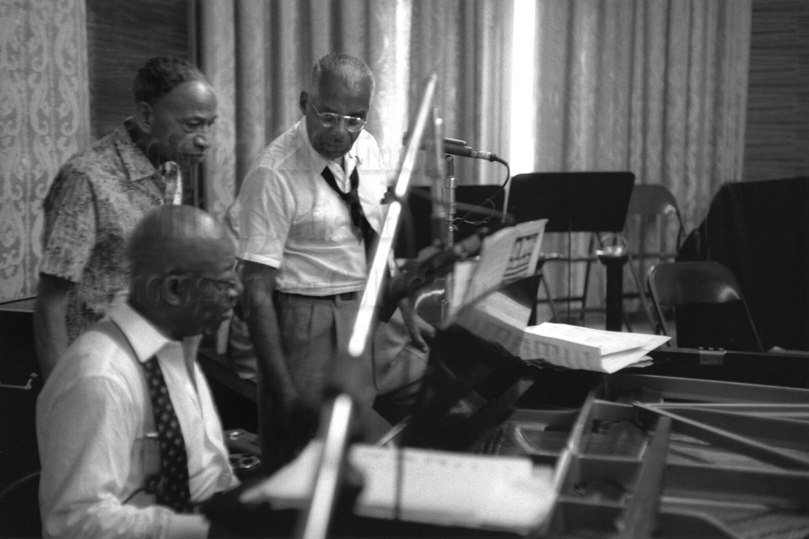 "Photo by Milt Hinton<br> © Milton J. Hinton<br>Photographic Collection <br><b class=""captionn"">Perry Bradford, Eubie Blake (at piano), and Noble Sissle, NYC c. 1958</b>"