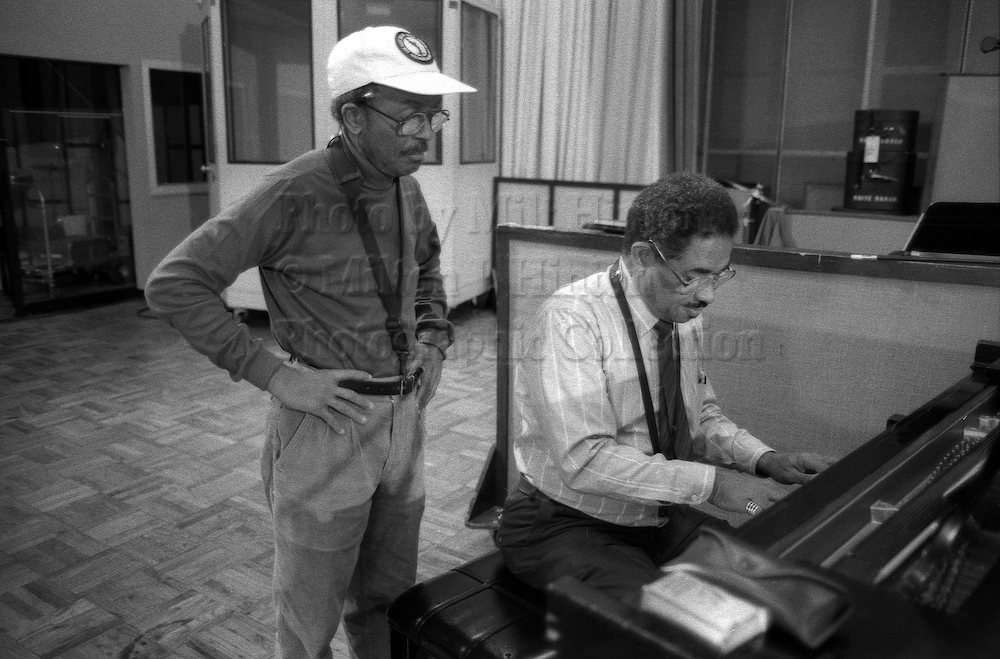 "Photo by Milt Hinton<br> © Milton J. Hinton<br> Photographic Collection <br> <b class=""captionn"">Jimmy Heath and Frank Wess, recording studio, New York City, 1989</b>"