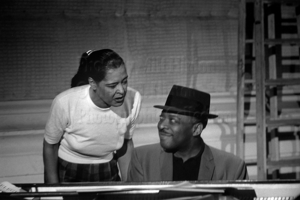 "Photo by Milt Hinton<br> © Milton J. Hinton<br>Photographic Collection <br><b class=""captionn"">Billie Holiday and Count Basie, television studio (Sound of Jazz rehearsal), New York City, 1957</b>"