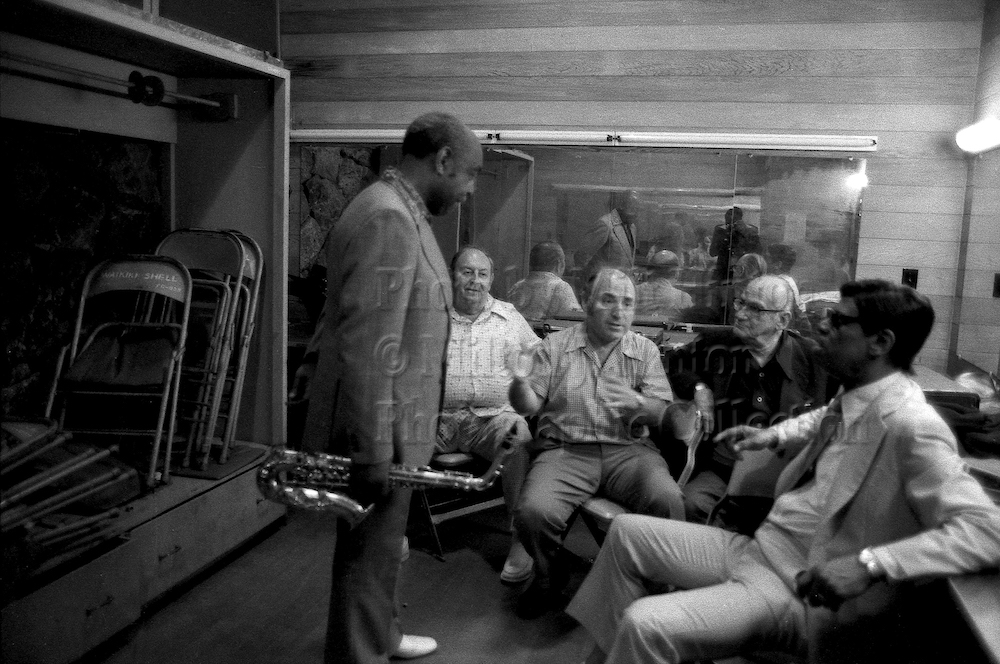 "Photo by Milt Hinton<br> © Milton J. Hinton<br> Photographic Collection <br> <b class=""captionn"">Benny Carter, Larry Wein, George Wein, and Earl Hines, Kool Jazz Festival, Honolulu, 1977</b>"