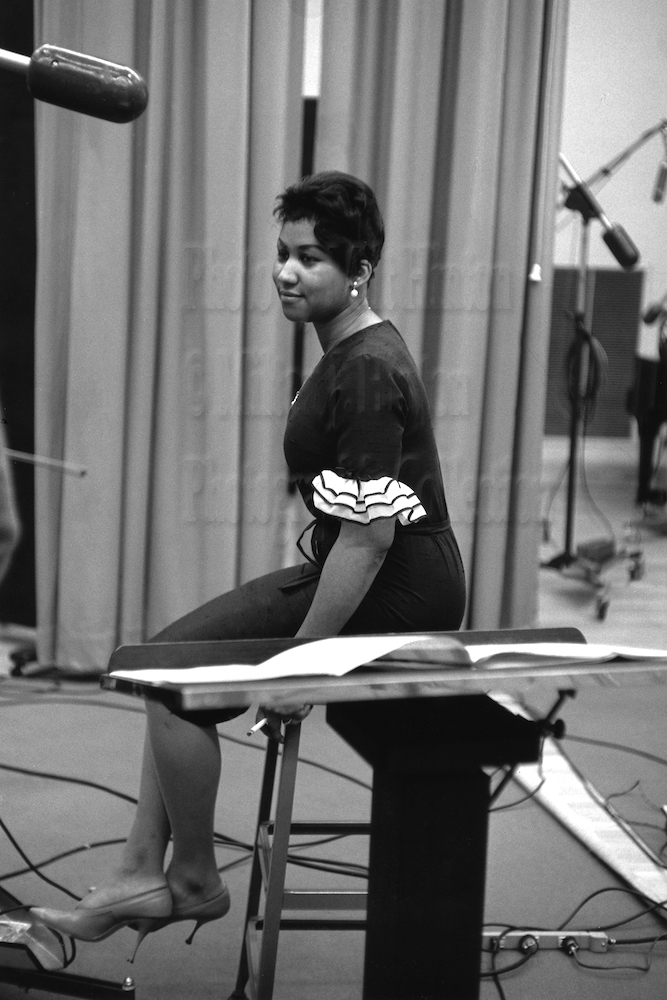 "Photo by Milt Hinton<br> © Milton J. Hinton<br>Photographic Collection <br><b class=""captionn"">Aretha Franklin, recording studio, New York City, c. 1961</b>"