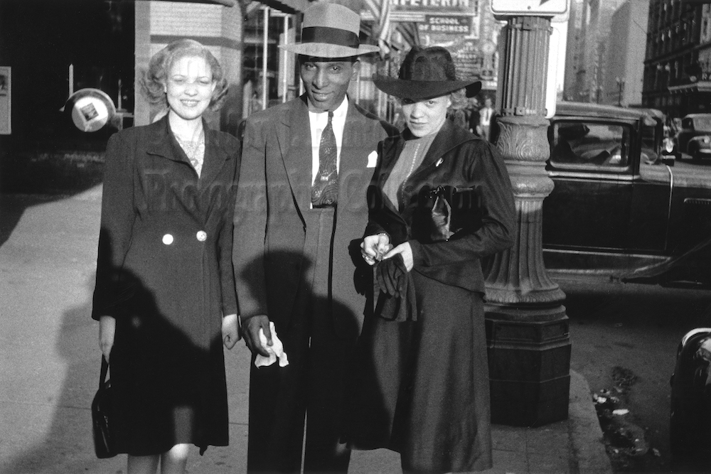 "Photo by Milt Hinton<br> © Milton J. Hinton<br>Photographic Collection <br><b class=""captionn""> Cozy Cole and two friends, outside the Apollo Theatre, Harlem, New York City, c. 1939</b>"