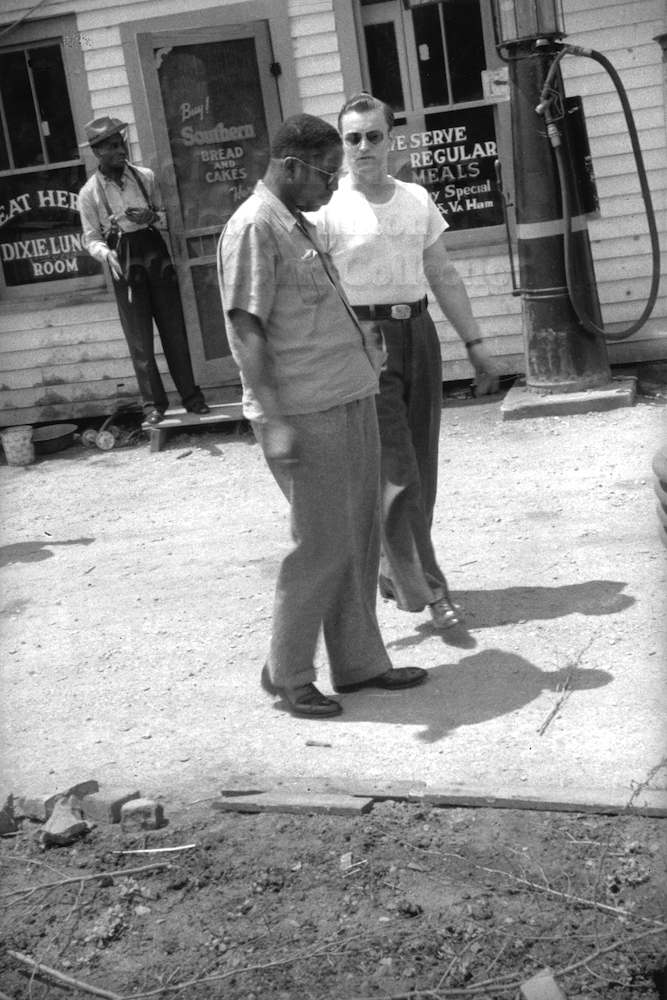 "Photo by Milt Hinton<br> © Milton J. Hinton<br> Photographic Collection <br><b class=""captionn""> Cozy Cole (background), Hilton Jefferson, and bus driver, Alabama, c. 1940</b>"