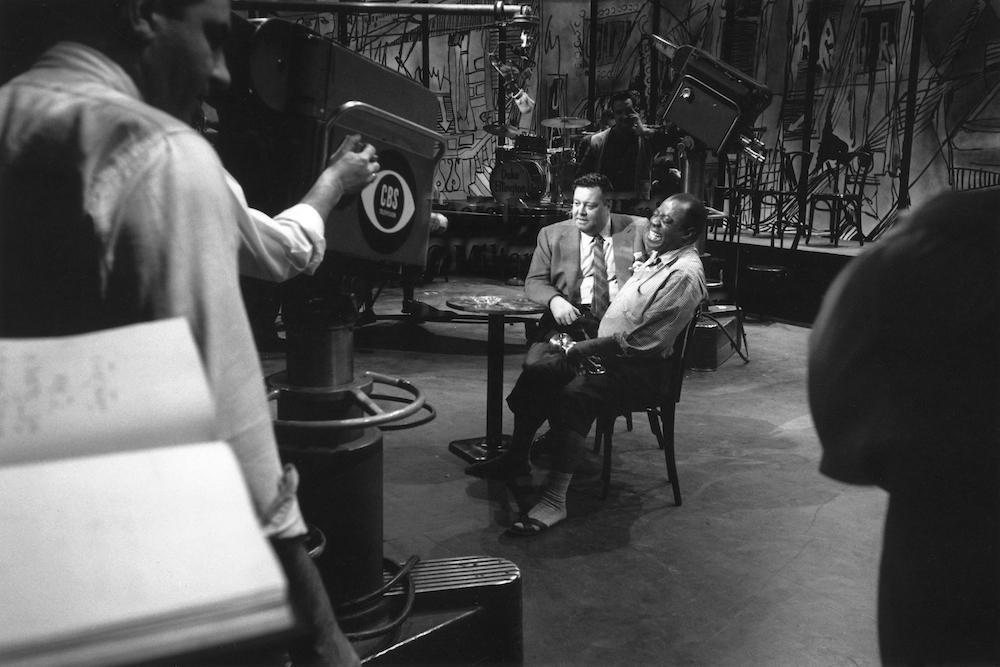 "Photo by Milt Hinton<br> © Milton J. Hinton<br>Photographic Collection <br><b class=""captionn"">Jackie Gleason and Louis Armstrong, television studio, (Timex rehearsal), New York City, 1959</b>"