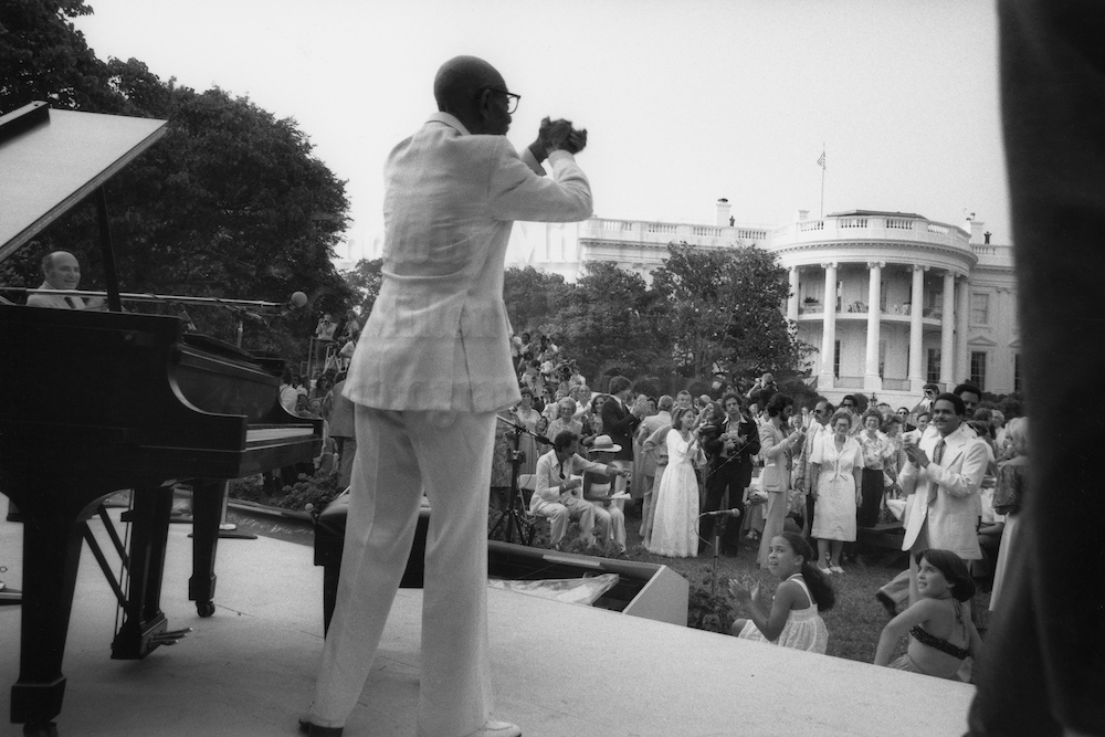 "Photo by Milt Hinton<br> © Milton J. Hinton<br>Photographic Collection <br><b class=""captionn"">Eubie Blake, concert (25th Anniversary of the Newport Jazz Festival), the White House, Washington, D.C., 1978</b>"
