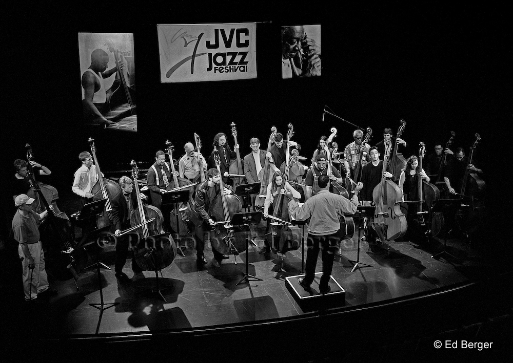 "© Photo by Ed Berger <br> <b class=""captionn"">John Clayton conducting (center, back to camera); Front Row: Jay Leonhart, Martin Wind, Brian Torff, Mary Ann McSweeney, Christian McBride, David Wong, and Nicky Parrot; Back Row: Kyle Eastwood, Tom Jensen, Fred Hunter, Bill Crow, Fumio Tashiro, Elias Bailey, Doug Weiss, Jennifer Vincent, Richard Davis, David Ruffels, Paul Beaudry, and Darryl Hall, rehearsal for Milt Hinton's 90th birthday concert, JVC Jazz Festival, Danny Kaye Theatre, New York City, June 2000 (© Ed Berger)</b>"