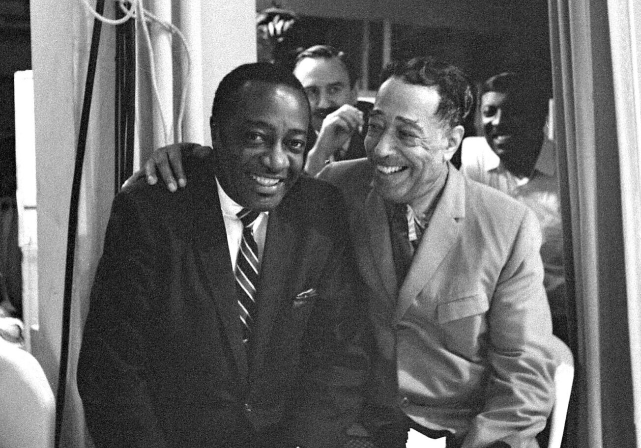 Duke Ellington (Earl Hines in background) with Milt